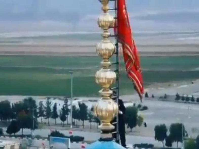 Λάβαρα πολέμου στο Ιράν: Πρώτη φορά κόκκινη σημαία στο πιο ιερό τζαμί των Σιιτών (Video)